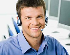 office worker in blue shirt smiling and wearing a headset